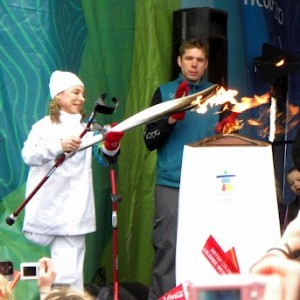Sarah Doherty Lighting the Olympic torch